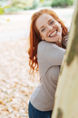 Attractive young redhead woman with a lovely smile