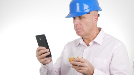 Engineer Image Eat a Sandwich and Text Using Cellphone