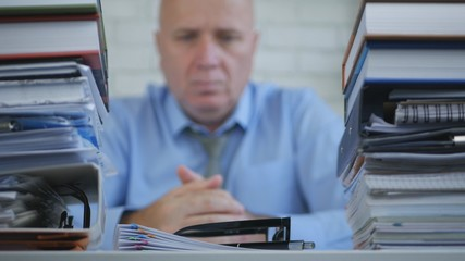 Blurred Image of Confident Businessman Thinking Pensive in Accounting Office