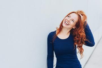 Attractive vivacious young redhead woman
