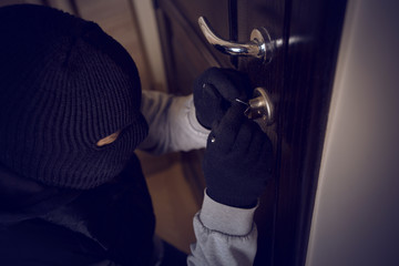 burglar breaking into the lock
