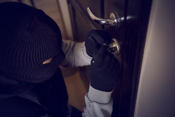 burglar breaking into the lock - fototapety na wymiar