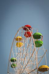 Ferris or devil wheel against blue sky background