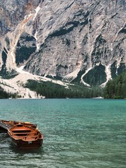 Boats with oars on the azure mountain lake in the Dolomites