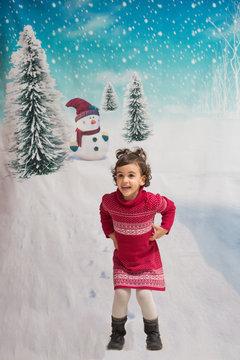 Pretty little girl posing at Christmas
