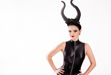 girl in a witch costume with horns
