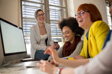 Smiling young women in office working