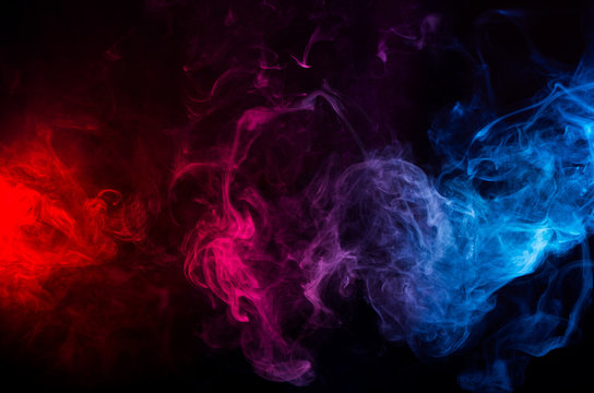 abstract shapes of mixed colors of blue and red smoke at dark background
