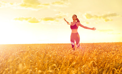 Sporty woman in wheat field
