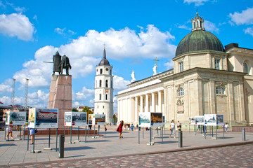 The Cathedral Square, main square of the Vilnius Old Town, with tower, Gediminas statue and tourists enjoying the city and the sun, Lithuania, Europe