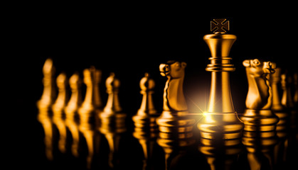 business strategy ideas concept golden chess competitive game dark color tone