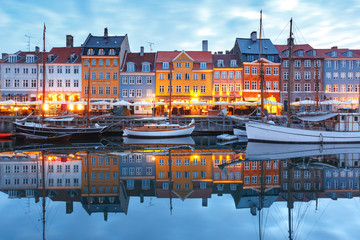 Foto auf Leinwand Skandinavien Panorama of north side of Nyhavn with colorful facades of old houses and old ships in the Old Town of Copenhagen, capital of Denmark.