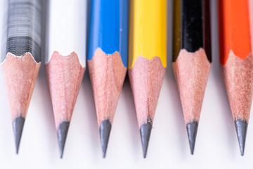 Several sharp new lead graphite pencils of various colors and patterns
