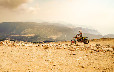 Fethiye, Mugla/Turkey- August 19 2018: Mountain motor biker riding on dusty road on Babadag