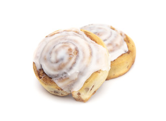 Two Frosted Cinnamon Rolls on a White Background