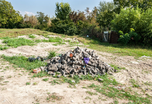Big pile of paving stone as remains after reconstruction of parking lot in the city