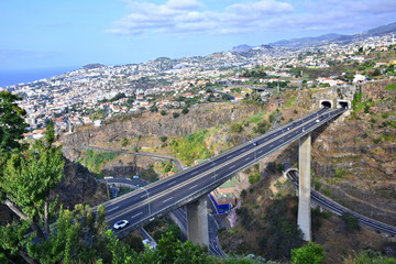 View of Funchal city with highway bridge and architecture, Madeira island, Portugal