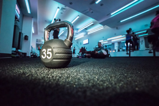 Dumbbell in after work workout fitness class with people doing sport workout
