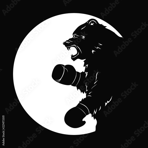 black bear in boxing gloves silhouette of a wild animal emblem of