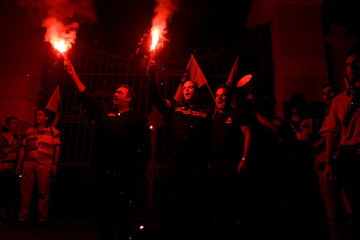 Police officers hold flares during an anti-austerity rally of uniformed staff of the public sector, a day before the opening of the annual International Trade Fair of Thessaloniki