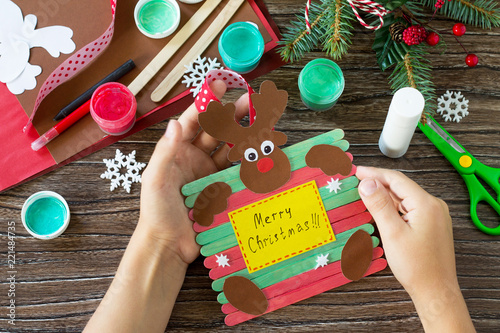 A Child Is Holding Santa And Reindeer Stick Gift Handmade Project