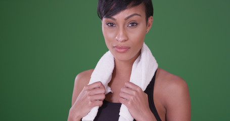 Portrait of sporty african american woman holding towel on green screen