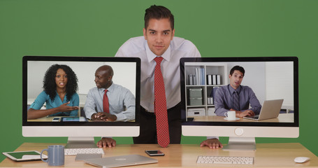Businessman looking at camera during video conference call with colleagues