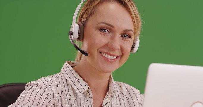 Friendly customer service representative smiling at camera on green screen