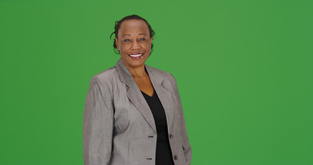 Successful African American businesswoman smiling on green screen