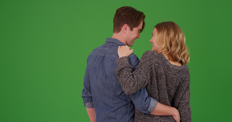 Rear view of happy couple being romantic with each other on green screen Wall mural