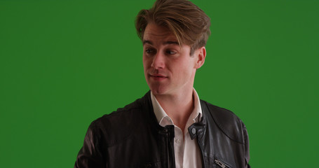 Portrait of handsome white man in leather jacket on green screen