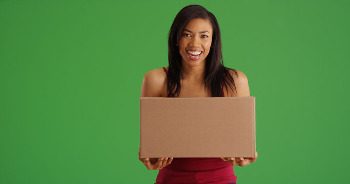 Happy African American woman with box mail package on green screen