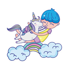 happy boy hugging unicorn with rainbow and clouds