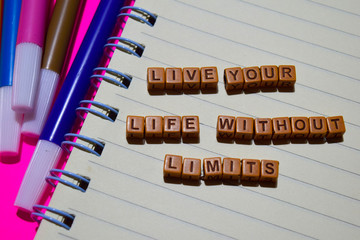 Live your life without limits message written on wooden blocks. Motivation concepts. Cross processed image