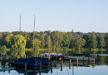 Boat dock with sailboats in the early morning. Location: Germany, North Rhine Westphalia, Hoxfeld