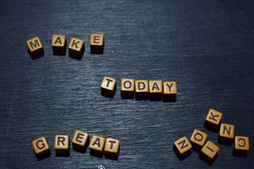 Make today great message written on wooden blocks. Motivation concepts. Cross processed image