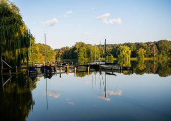 romantic boat dock with reflections in the water. Location: Germany, North Rhine Westphalia, Hoxfeld