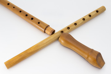 A Baroque recorder and a folk six-hole flute crossing