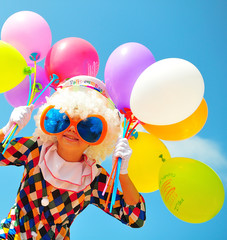 Foto op Aluminium Carnaval funny kid clown with balloons