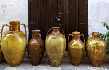 Terracotta vases of different sizes that were used in Puglia to contain olive oil