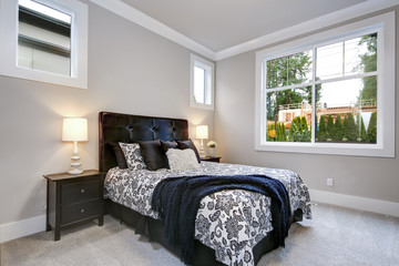 Guest modern bedroom interior with grey walls and windows