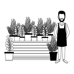 Gardener with plants in black and white