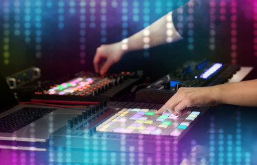Hand mixing music on dj controller with social media concept icons