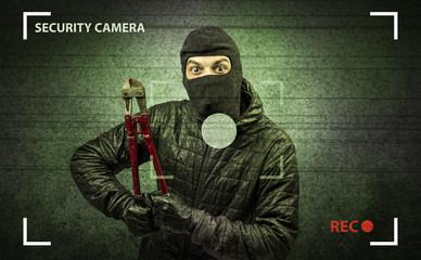 Caught burglar by house camera in action. - fototapety na wymiar