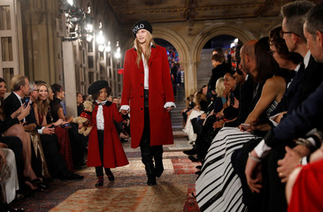 Models present a collection at Ralph Lauren's 50th anniversary fashion event during New York Fashion Week in New York