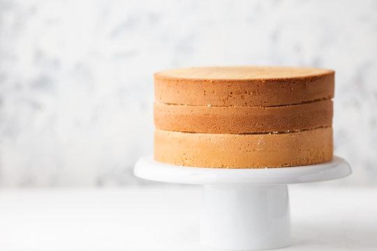Sponge cake. Shortcakes on a white cake stand