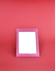 the mirror in a pink frame on a pink background