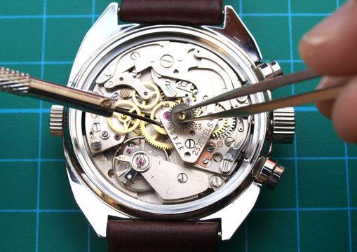 watchmaker working repairing watch