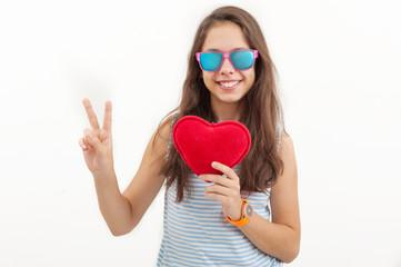 Teenage girl holding a plush heart