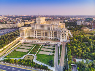 Parliament building or People's House in Bucharest city. Aerial view at sunset with blue sky